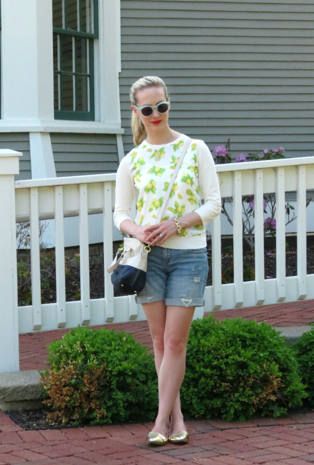 ann taylor lemon sweater, distressed jean shorts, gold flats, mint hepcat sunglasses, monogram necklace