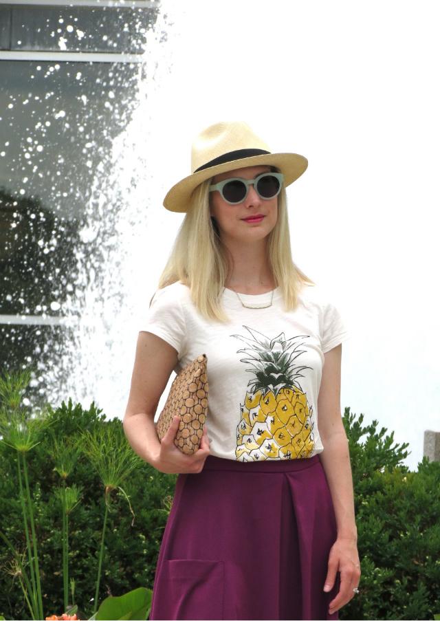cork clutch, ann taylor pineapple tee, asos midi skirt, j crew panama hat