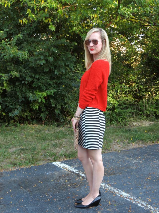 cropped sweater, striped mini skirt, low black wedges, pink ray ban aviators, spike bracelet, leopard watch
