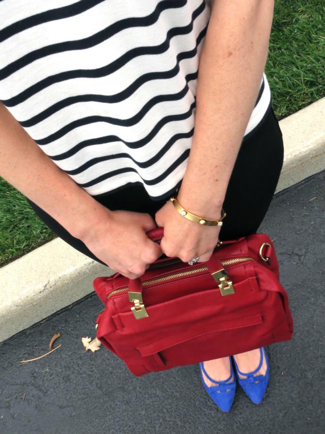leather sleeve striped tee, target ponte pants, red satchel, cobalt blue bow flats, marc jacobs pretzel earrings